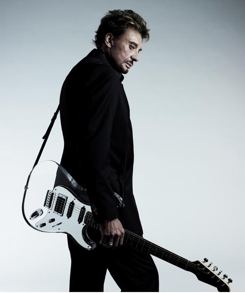Photo de Johnny Hallyday avec guitare